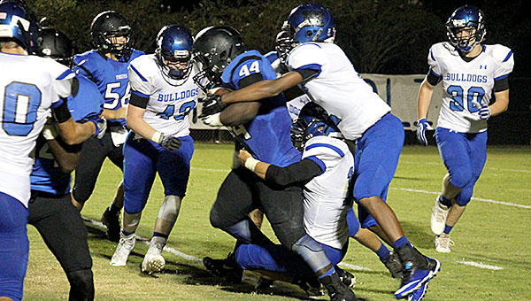 Tyler Gamble pulls forward for positive yardage against the Marbury defense. Gamble, a freshman, had one of the biggest plays of the season so far when he broke for a 99-yard touchdown run late in the first half.