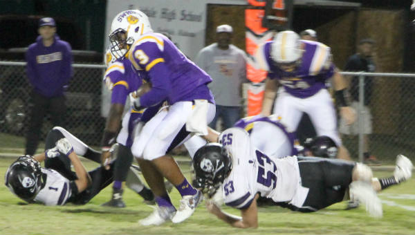 R.J. Rodgers pulls away from a Fruitdale defender for positive yardage in Friday night's game in Sweet Water.