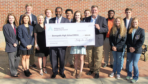 """Members of the Demopolis High School DECA Club were presented a $500 grand prize for a video contest titled """"Tell Your Story."""" Pictured along with members of the club are DECA Sponsor Connie Davis, Craig Collins of the Career Tech Education Leadership Council, and DHS Principal Chris Tangle."""