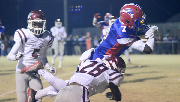 Dequan Charleston makes a diving leap towards the goal line during the Patriots' loss to Maplesville in the fourth round of the AHSAA playoffs. Charleston scored the only offensive touchdown of the night for Linden.