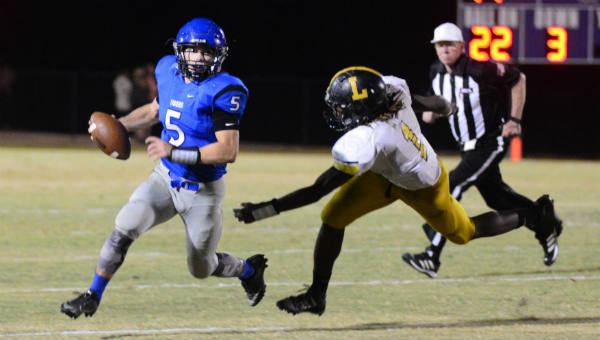 Logan McVay eludes a tackle in the Tigers' first round loss to Lincoln