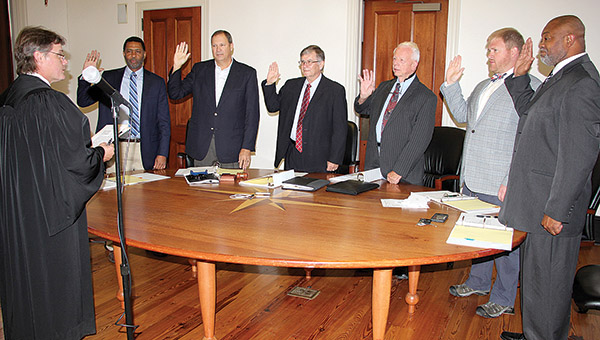The latest administration to lead Demopolis city government took the oath of office Monday. District Judge Vince Deas presided over the ceremony. Those being sworn into office included, from left, District 1 Councilman Charles Jones, District 4 Councilman Bill Meador, Demopolis Mayor John Laney, District 5 Councilman Cleveland Cole, District 2 Councilman Harris Nelson, and District 1 Councilman Nathan Hardy.