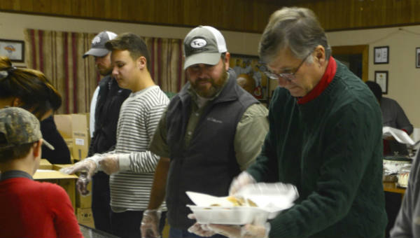 Demopolis Mayor John Laney was on hand at Kora's Place Restaurant along with dozens of volunteers including other city and Marengo County and Sumter County officials volunteering time on the morning of Christmas Eve putting together plates for members of the community in Demopolis and surrounding communities in Marengo, Hale, Greene and Sumter Counties. In all, the Coming Together Organization and the group of volunteers on hand  were able to make 2,550 plates to feed the community.