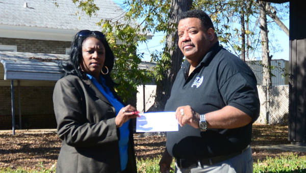 Valeria J. Miller on behalf of Mutual Savings Life Insurance presents a $250 donation to the Coming Together Organization to help with the Christmas Feeding event along with various endeavors of CTO during the Christmas season.