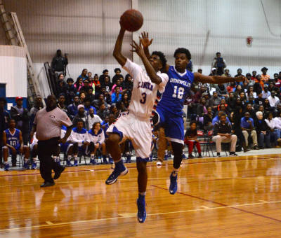 Jaquarius Varner, going for a layup against Melvin Childers of DHS, was one of four Patriots in double figures in the 55-44 victory over Demopolis.