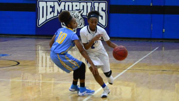 Aniya Johnson drives to the hoop against Selma