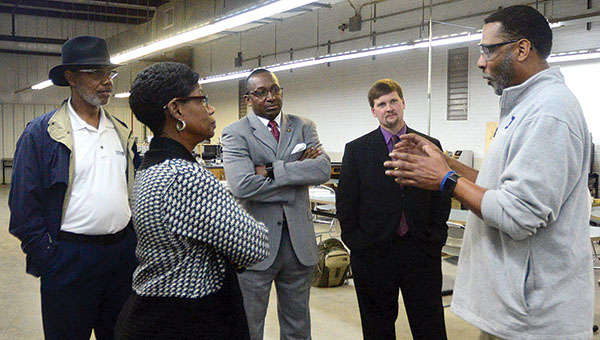 Charles Jones speaks Tuesday with State Representatives A.J. McCampbell and Bobby Singleton, back from right, as well as Demopolis Superintendent Kyle Kallhoff and School Board Member Carolyn Moore. The legislators received a tour of the career tech facility and visited the gifted classroom at U.S. Jones Elementary.
