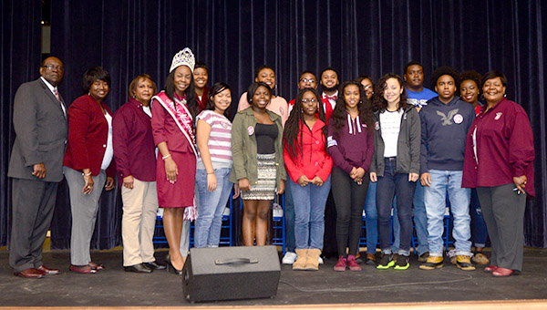 Alabama A&M University President Andrew Hugine (left) and poses with current AAMU students, alumni and DHS students who received scholarships during the AAMU Presidential Community Engagement bus tour. President Hugine made the trip to Demopolis to speak with students from DHS, Linden High School and Greene County High School.