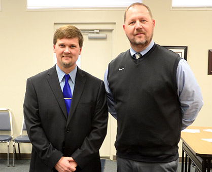 Brian Seymore, right, was introduced as the new head football coach of Demopolis High School during a called BOE meeting on Feb. 2. He is pictured with DCSS Superintendent Kyle Kallhoff.